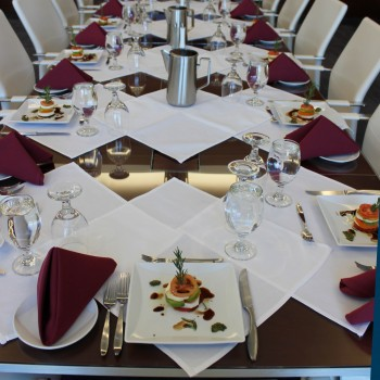 Table set with formal place settings and gourmet salads