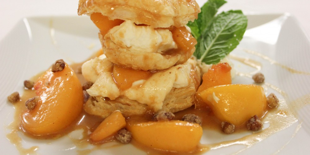 Peach shortcake garnished with mint leaves