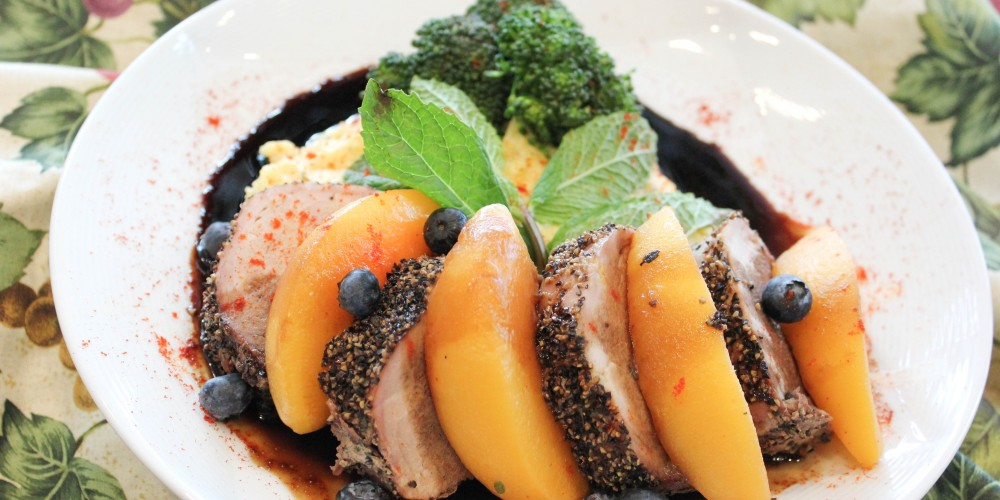 Alternating slices of pork tenderloin and peaches