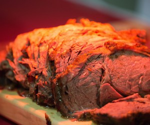 Sliced roast beef under a heat lamp